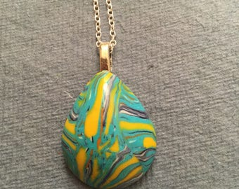 Domed tear drop shaped pendant