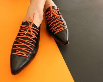 Black leather flat laces shoes
