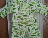 Pajama set 0 to 3 months. Flannel. Item lined in same. Sweet green pea theme on white background. Snap top. Elastic gathered waist.