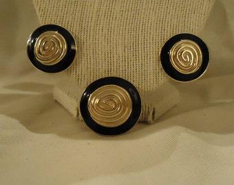 Clip Earrings Brooch by Weekenders Black Enamel Gold Metal Material Round Shaped Pressed Metal Gold Swirls Vintage 1980's Costume Jewelry