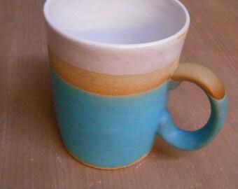 Turquoise blue dipped Stoneware ceramic mug.