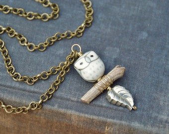 Owl on branch long brass necklace