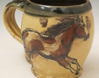 Large mug with slip trailed horses