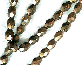 vintage glass beads faceted COPPER COLOR unusual twenty five beads western germany, they LOOK like metal but they are glass