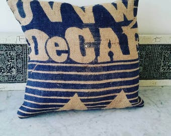 Reclaimed burlap coffee bean bag pillow in navy blue with a decaf logo