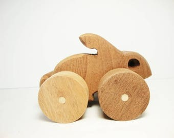 vintage rabbit wood push toy  hand crafted rustic wooden bunny
