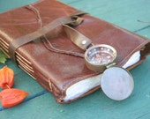 Custom leather travel journal with map and compass