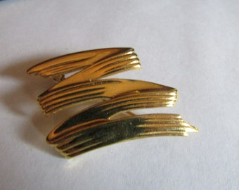 Gold line zipper brooch