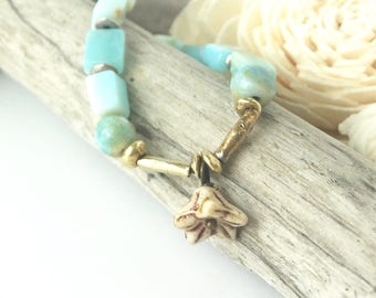 aqua beaded necklace, flower charm necklace, flower charm beaded necklace, gold and blue beaded necklace, summer necklace
