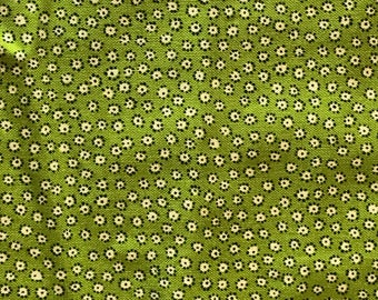 Green Fabric With White Flowers