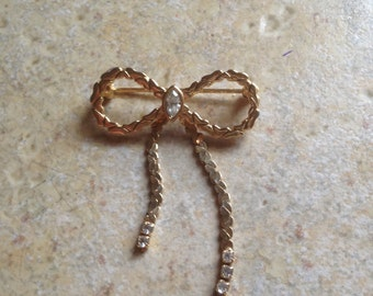 Rhinestone Goldtone Bow Brooch by Avon