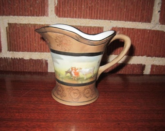 Vintage Lovely Porcelain Creamer with Hand Painted Cattle Design