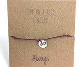 Limitless. Sterling Silver Hand Stamped Infinity Bracelet on Cord.