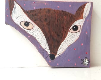 Painting on reclaimed wood of a fox face