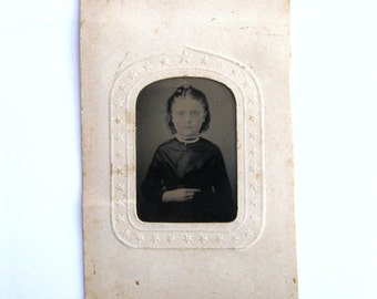 Unusual Antique Tintype Photo Somber Girl Pointing Left