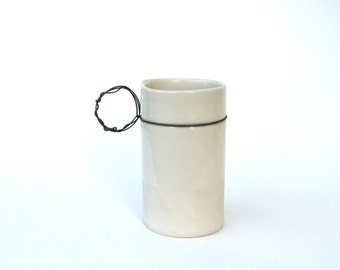 hand built porcelain cup  ...  steel and clay   ...   minimal