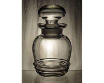 Antique glass storage jar / Vintage bottle or posy vase with ribbed base pattern