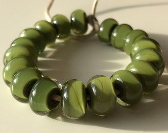 Unknown olive green encased with clear - 18 handmade lampwork beads