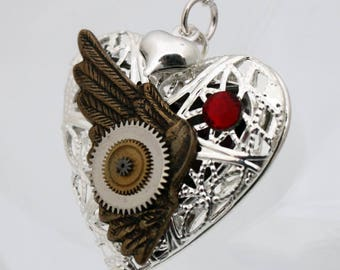 Steampunk locket silver plated filigree heart with red Swarovski crystals, vintage watch parts, heart charm and brass wing- Romantic jewelry