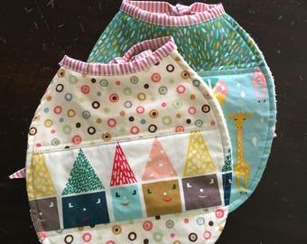 2  baby bibs using the Cloud 9 Happy Town fabric line with terry cloth and layer of waterproof fabric. baby bib, bibs, terry bib. tie bib