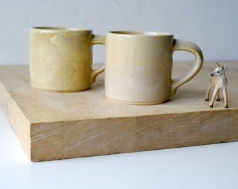 Set of two stoneware pottery Americano coffee cups - glazed in pepper yellow