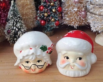 SPRING SALE Santa Claus and Mrs. Claus heads salt and pepper shaker set.