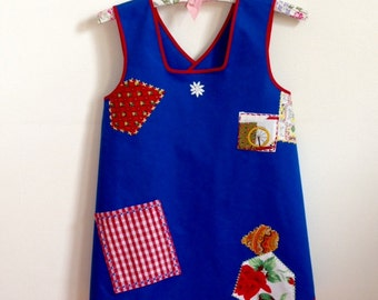 One of A Kind Child's Cross Back Apron Dress Costume Size 8, Blue with Patches