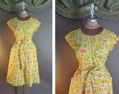 50s dress. 1950s vintage SUNNY FLOWERS green orange yellow floral cotton Swirl wrap full skirt dress