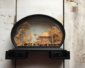 A well travelled room| handsome carved cork diorama | made in China