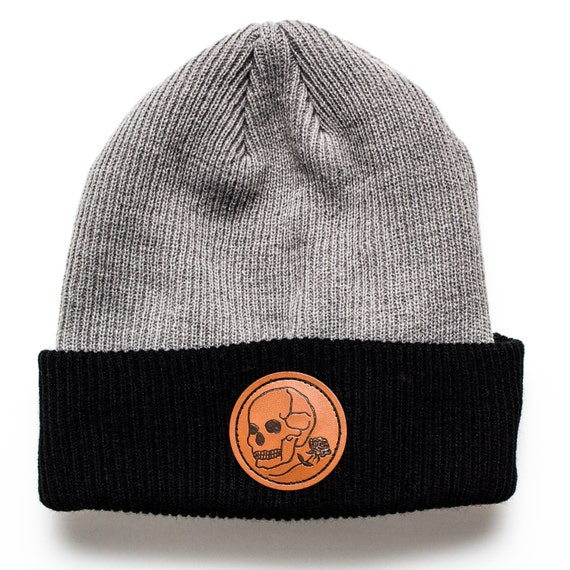 Skull and rose beanie. Mixed fabric two tone beanie with faux leather patch.