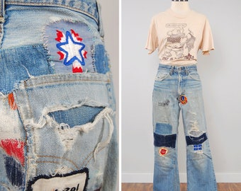 Vintage 70s LEVIS patched repaired faded jeans / Orange tab flares / Distressed thrashed jeans / 28 x 28 / LONE STAR Beer patch