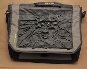 "Grichels leather and nylon 17"" Targus laptop computer bag - ""Sagips"" 28055 - black with steel blue slit pupil shark eyes"