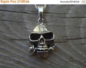 ON SALE Skull necklace in sterling silver with a rose