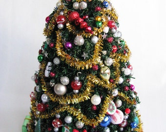 1:12 Toys & Fun Decorated Christmas Tree with Holiday Ornaments, Gold Garland and Tree Skirt by Crown Jewel Miniatures