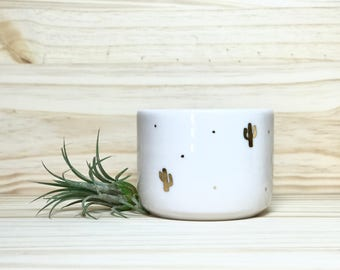 Small porcelain bowl with gold luster cactus decorations
