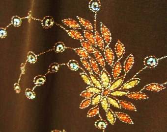sparkling skirt. lots of sparkles on a chocolate brown background