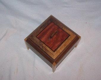 Walnut and Maple Legged Box with Bubinga inlayed  top