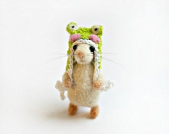 Tiny mouse in a frog hat