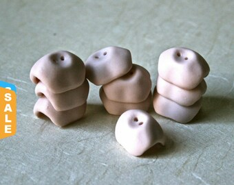 Closeout - Ten Tiny Porcelain Doll Shoulder Plates for Doll Making and Repair