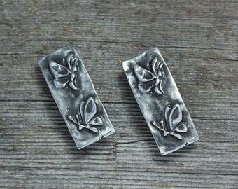Twin butterfly barrettes silver pewter