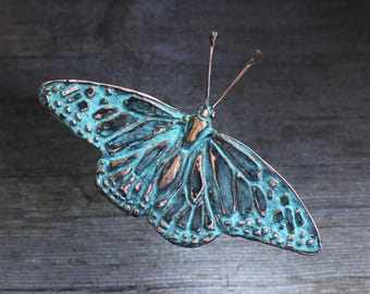 Monarch wall sculpture in copper with blue green patina