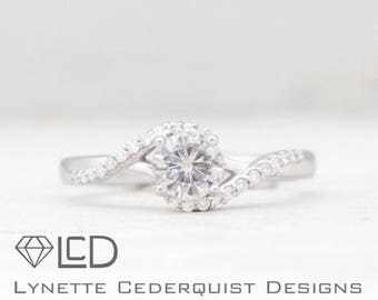 Delicate Bypass Accented Engagement Ring featuring a 1/2 carat Round Forever One Moissanite Engagement Ring LCDA018