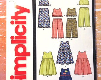 Simplicity 5988  EASY Toddlers' Dress or Top, and Pants Size A (1/2, 1, 2, 3, 4)