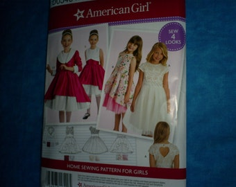 Simplicity 540 8283  Matching American Girl outfits. Size 3-8..
