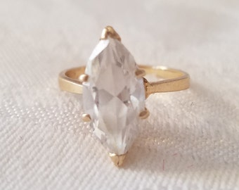 Vintage gold tone ring with clear rhinestone marquis prong-set stone