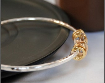 Seven Gold Rings on Silver Bangle