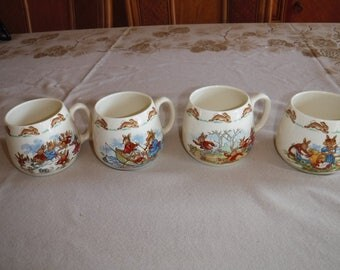 Bunnykins by Royal Daulton mugs lot of four Roller skating Row Boat Sledding and Playing with Dolls