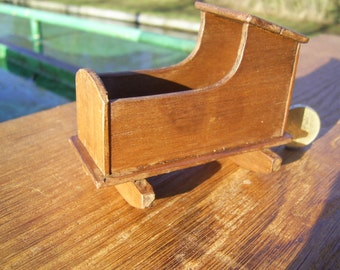 1:12th scale dollhouse miniature Tudor or later rocking cradle.