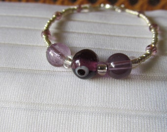 Dark Amethyst Eye and Silver Glass Bead Bracelet