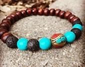 Wood lava stone and turquoise mala meditation yoga bracelet with tibetan bead unisex for men or women